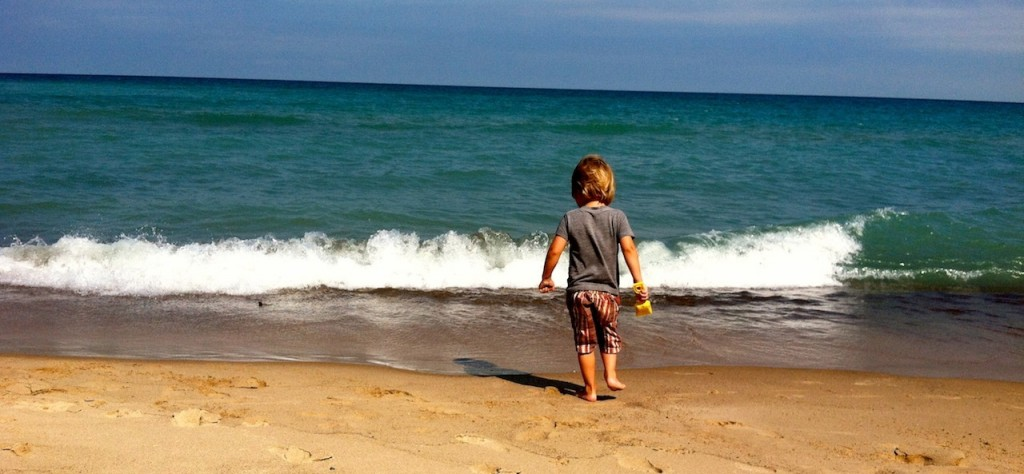 my son exploring the beach