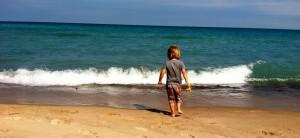 my son exploring the beach
