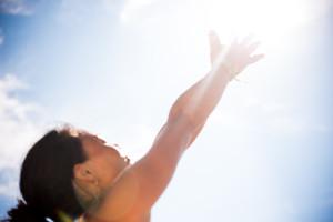 women-reaches-sun