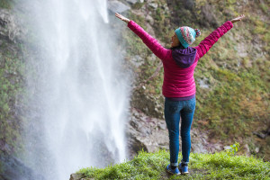 excited-woman-waterfall